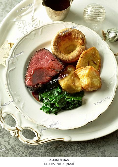 Sunday lunch with beef, Yorkshire pudding and roast potatoes (England)
