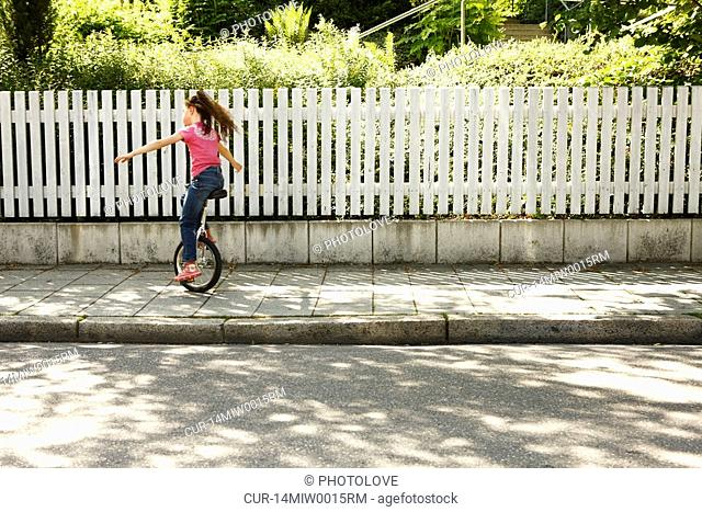Smart girl alone at home Stock Photos and Images | age fotostock