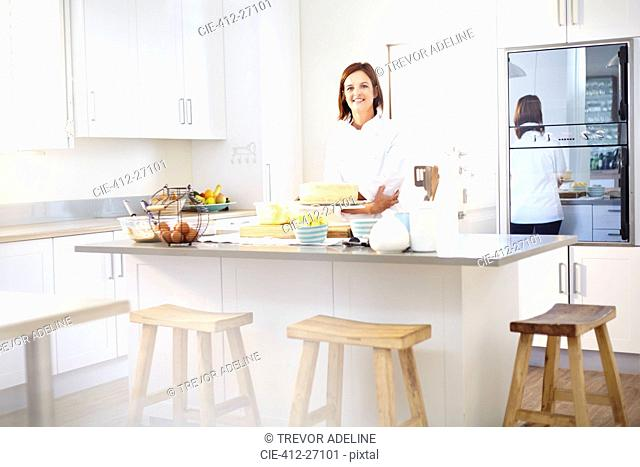 Portrait confident chef in kitchen