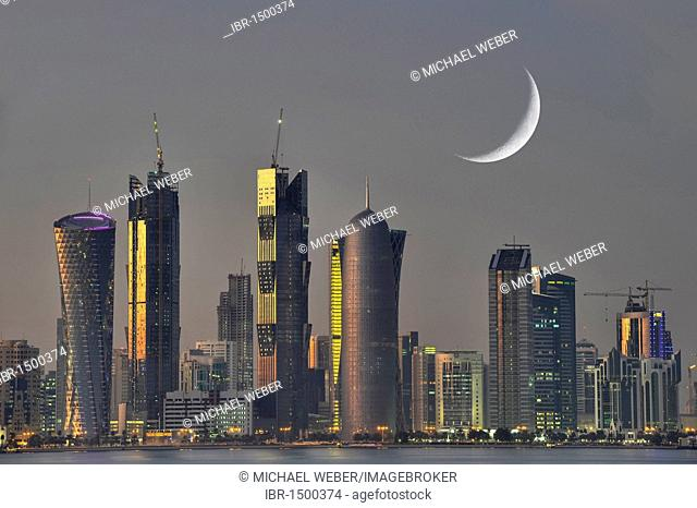 Twilight shot, skyline of Doha, Tornado Tower, Navigation Tower, Peace Towers, Al-Thani Tower, Moon, Doha, Qatar, Persian Gulf, Middle East, Asia
