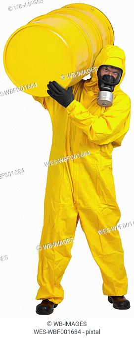 Mature man in yellow protective suit carrying ton