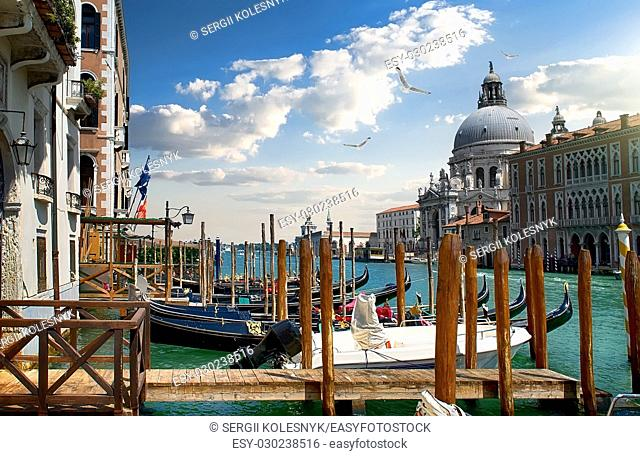 Beautiful venetian cityscape with gondolas and basilica, Italy