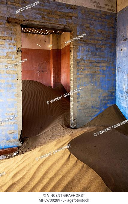 Sand-filled rooms in an abandoned house, Kolmanskop, Luderitz, Namibia