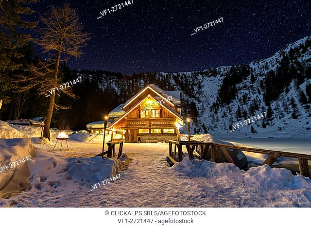 Italy, Trentino Alto Adige, starry night over Nambino refuge in natural park Adamello Brenta