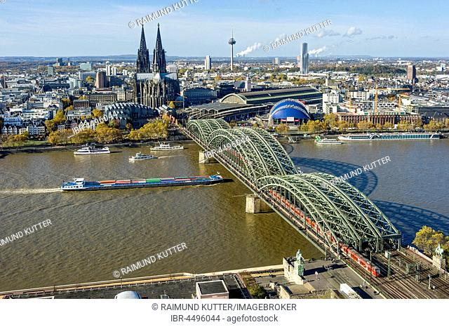 View over the river Rhine, Cologne's historic centre, Cargo Ship, Museum Ludwig, Cologne Cathedral, Hohenzollern Bridge, Central Station, Musical Dome