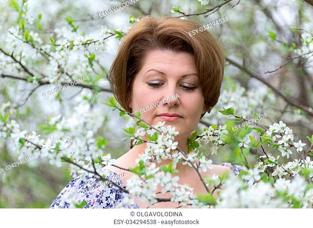 Woman with allergic rhinitis in the spring garden