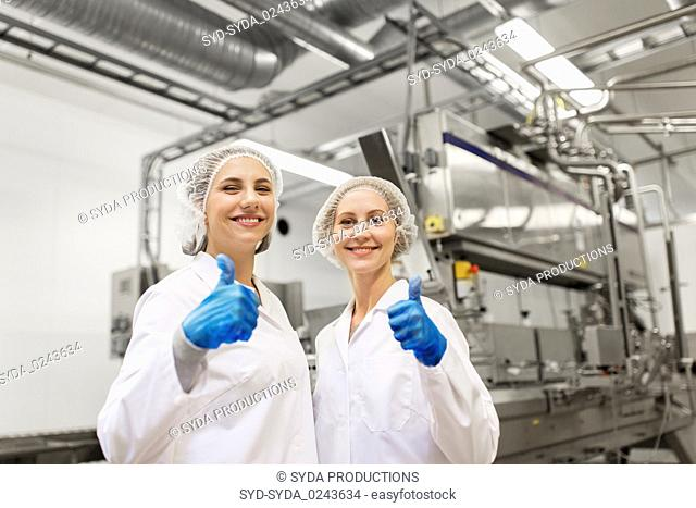 happy women technologists at ice cream factory