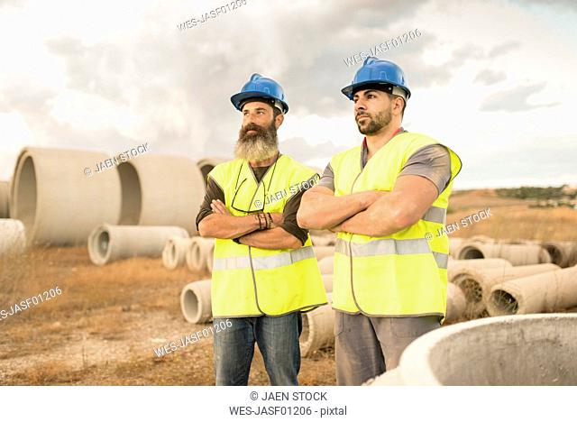 Two workers posing outdoors