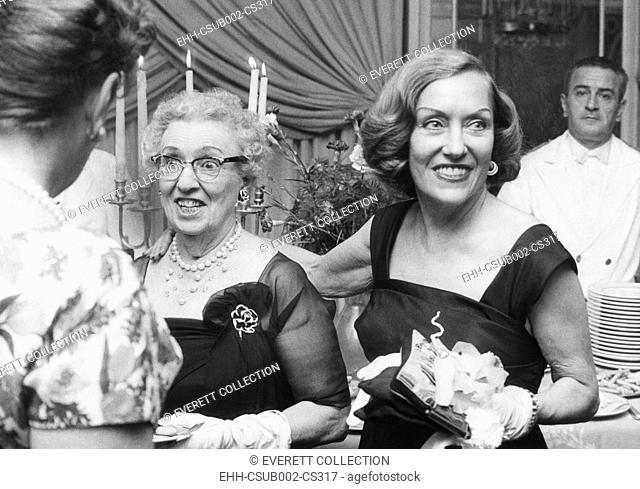 Actress Gloria Swanson (right) and her mother, Mrs. Charles Woodruff, holidaying in Rome. Sept. 27, 1961. Swanson tossed the party in honor of her mother at a...
