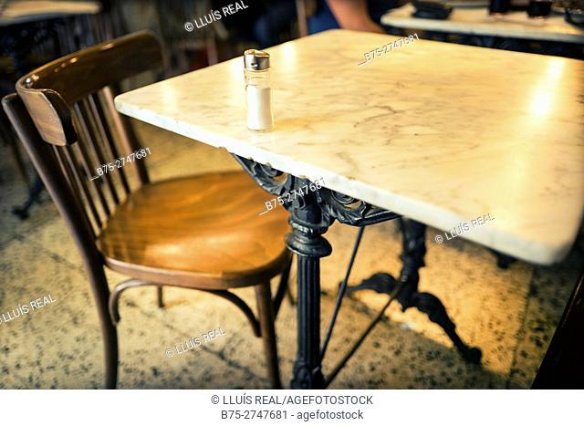 Salt shaker on a marble table in a bar. Barcelona, Catalonia, Spain