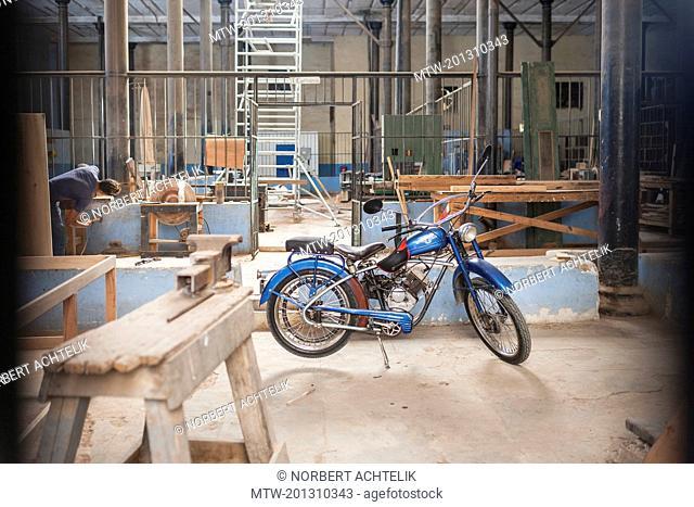 Moped in workshop, Havana, Cuba