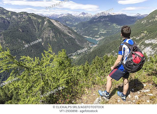 Europe, Italy, Veneto, San Tomaso Agordino, Dolomites, hiker looking Alleghe and the lake from the Col Mandro lookout