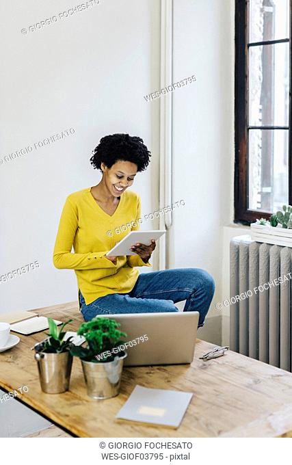 Young woman at home surfing the net, using digital tablet