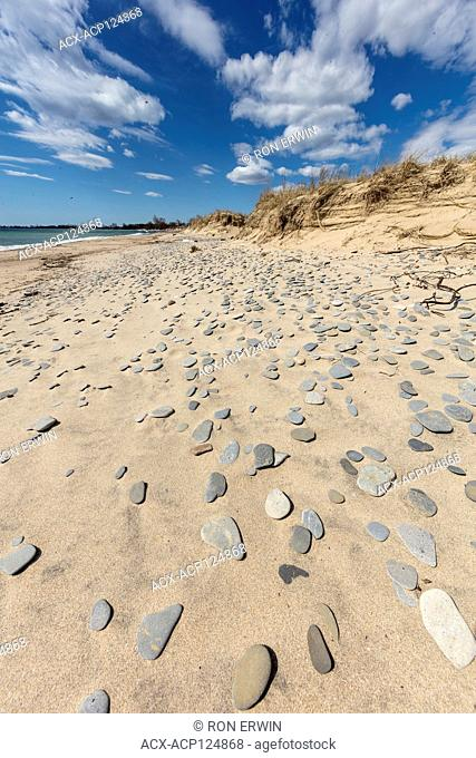 Flat stones on the beach at Big Sandy Bay on Wolfe Island, Ontario, Canada