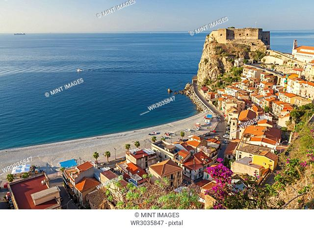 High angle view of seaside town with castle on cliff and sandy beach on the Mediterranean coast
