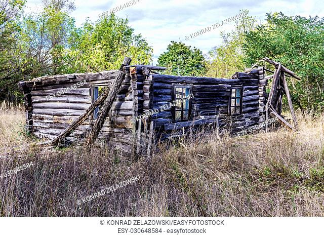 Ruined cottage in Mashevo village of Chernobyl Nuclear Power Plant Zone of Alienation area around nuclear reactor disaster in Ukraine