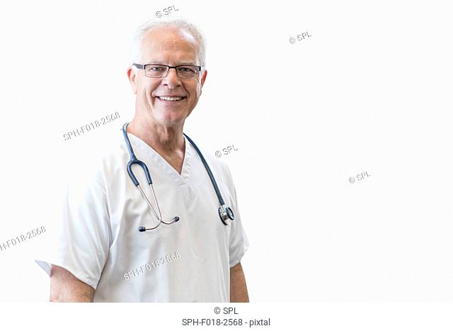 Senior male doctor smiling towards camera, portrait