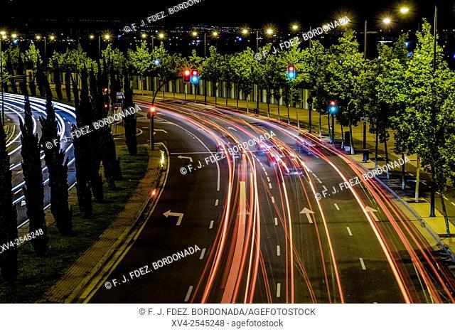 Trails of traffic light Expozaragoza. Saragossa by night, Aragon, Spain