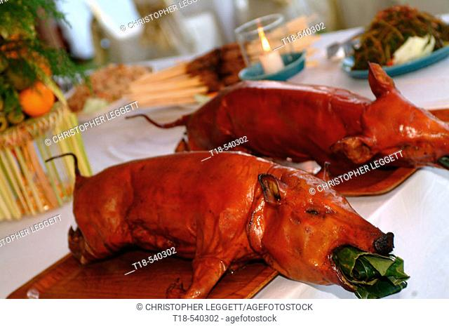 roasted suckling pig served on table in wedding party