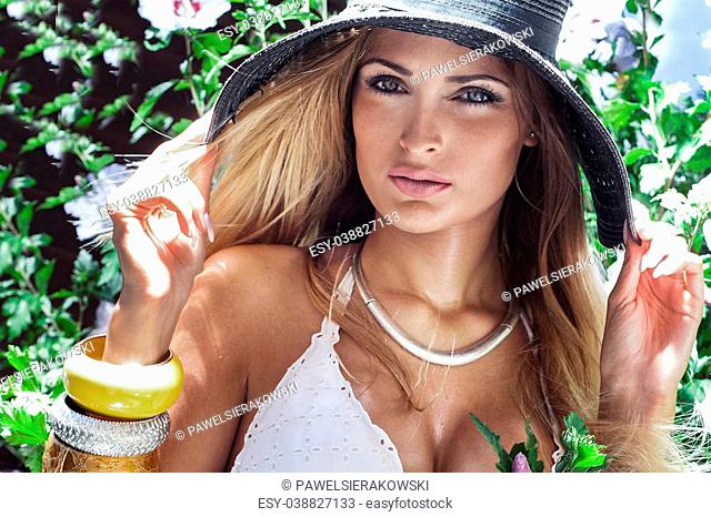 Beauty portrait of young attractive woman. Summer photo