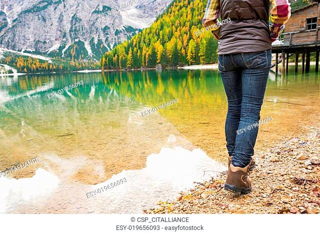 Closeup on young woman walking on lake braies in south tyrol, it