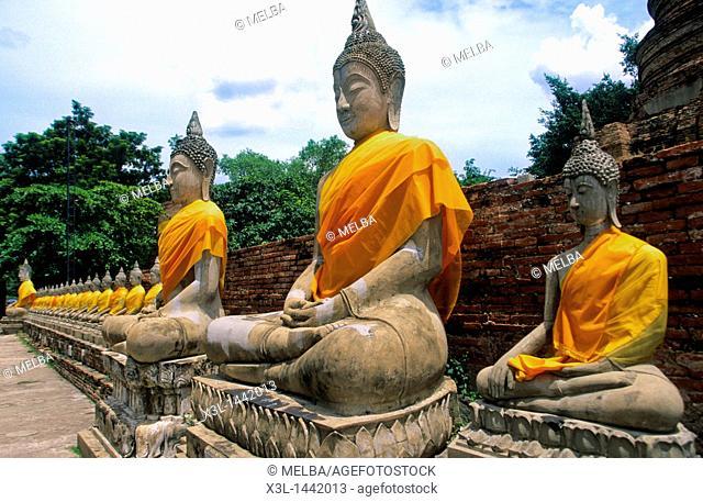 Buddha statues around the Great Chedi Chaya Mongkol, Thailand, Ayutthaya, Wat Yai Chai Mongkon
