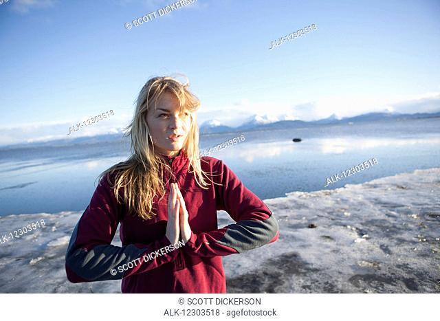 Woman an icy beach before a run on the Homer beach, Kenai Peninsula, Southcentral Alaska
