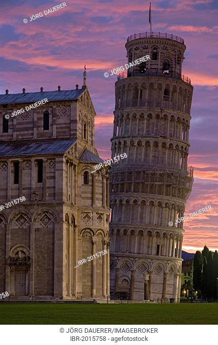 The Leaning Tower of Pisa against a spectacular sunrise, Tuscany, Italy, Europe