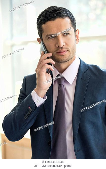 Executive using cell phone, portrait