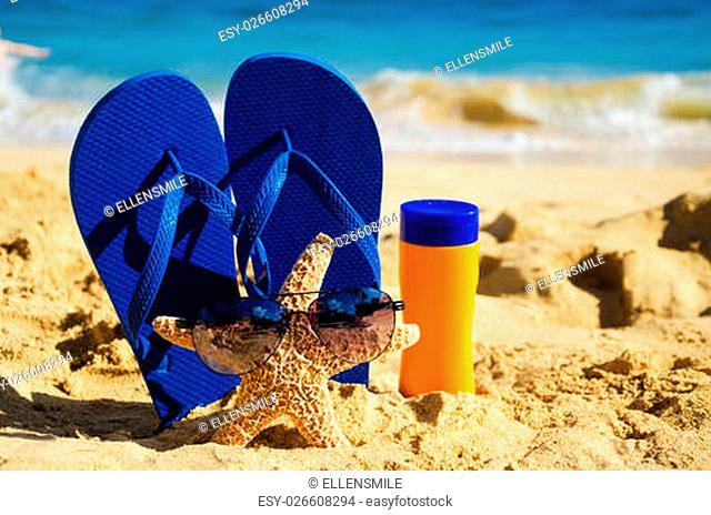 29e5ff9e67615 Sandal sand sunscreen Stock Photos and Images