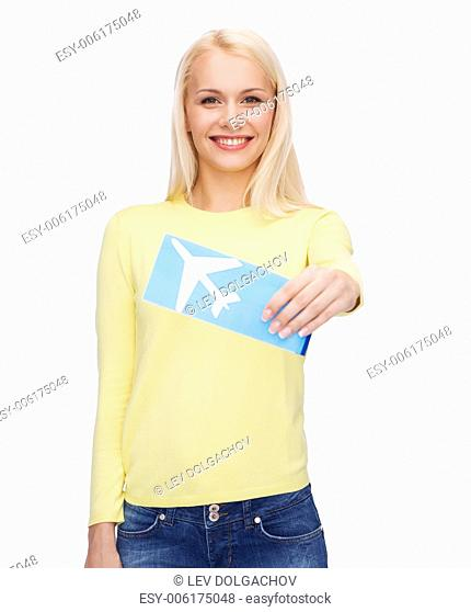 travel and transportation concept - smiling young woman with airplane ticket