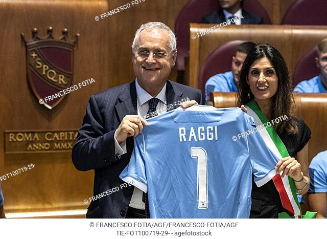 President of the S.S. Lazio Claudio Lotito gives to Mayor of Rome Virginia Raggi the jersey of Lazio during the prizegiving at Campidoglio Palace, Rome