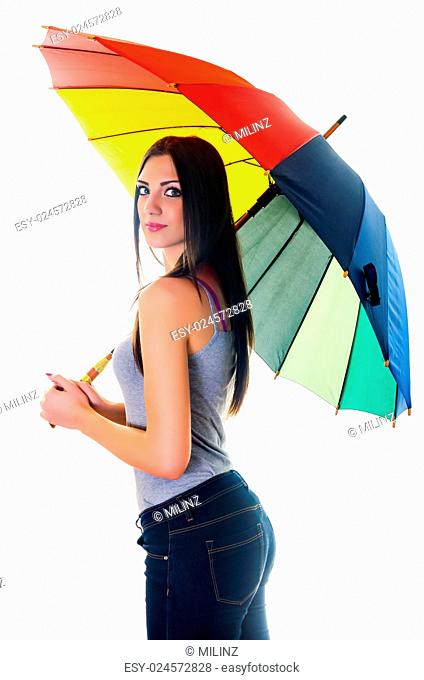 side portrait of beautiful brunette female with rainbow umbrella over white background