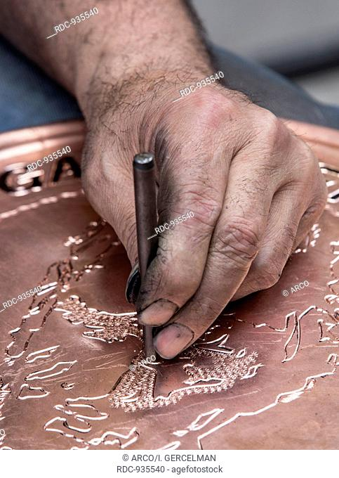 Making pattern on copper tray, Gaziantep, Turkey