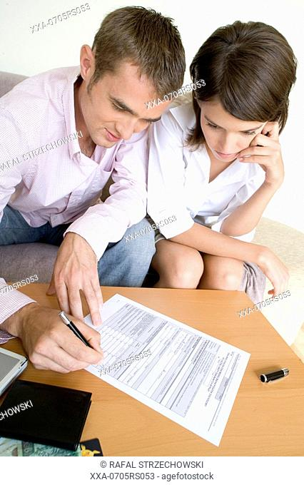 couple filling documents