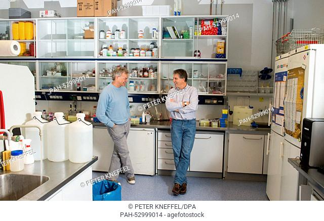 Nobel prize winner for Medicine Edvard Moser (L) and the director of the Max-Plank-Institute, Tobias Bonhoeffer, stand in a laboratory of the institutes...