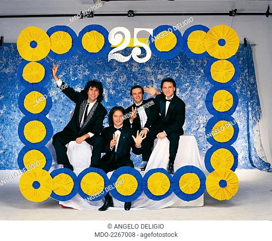 Italian band Pooh posing in a blue and yellow papier-mache frame during a photo shoot realized on the occasion of the celebration of twenty five years of career