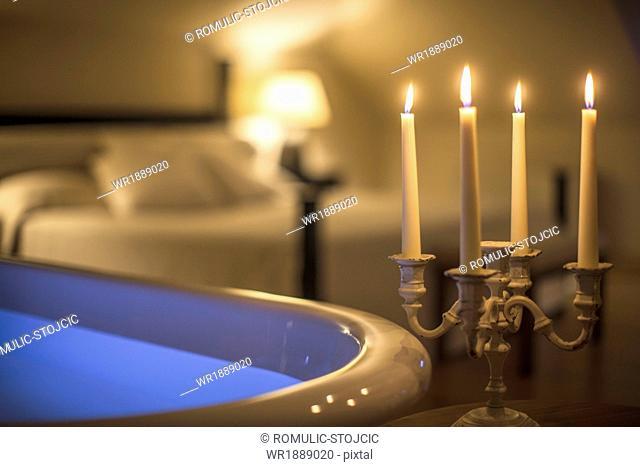 Lit candles alongside bathtub in tourist resort, Dubrovnik, Croatia