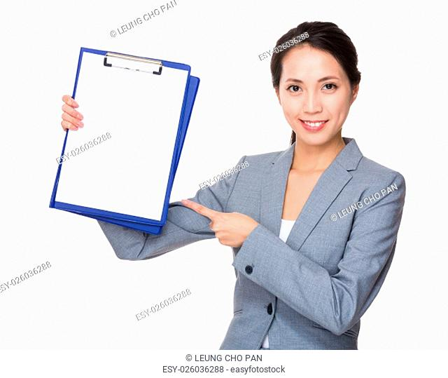 Young Businesswoman showing with blank page of clipboard