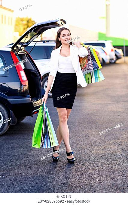 Woman after shopping in a mall or shopping centre and driving home now with her car