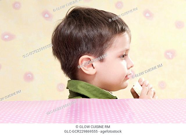 Close-up of a boy holding a chocolate bar