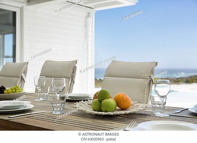 Placesettings on beach house patio table