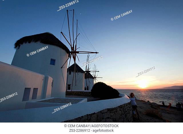 Traditional windmills at sunset in Mykonos town, Mykonos, Cyclades Islands, Greek Islands, Greece, Europe