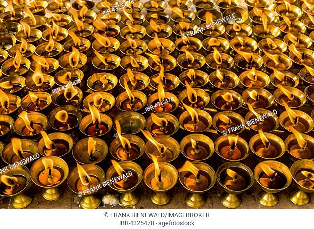 Many butter lamps are lightened at a temple in Boudha, Kathmandu, Nepal