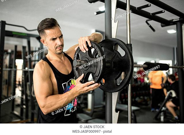 Man preparing to train with fitness bar