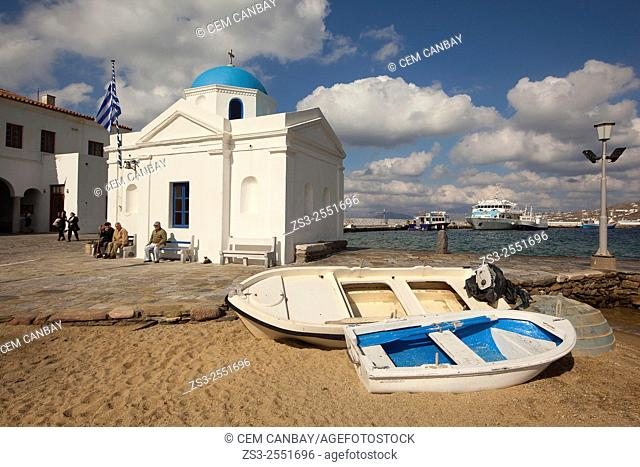 Fishing boats in front of a blue domed church by the sea, Mykonos, Cyclades Islands, Greek Islands, Greece, Europe