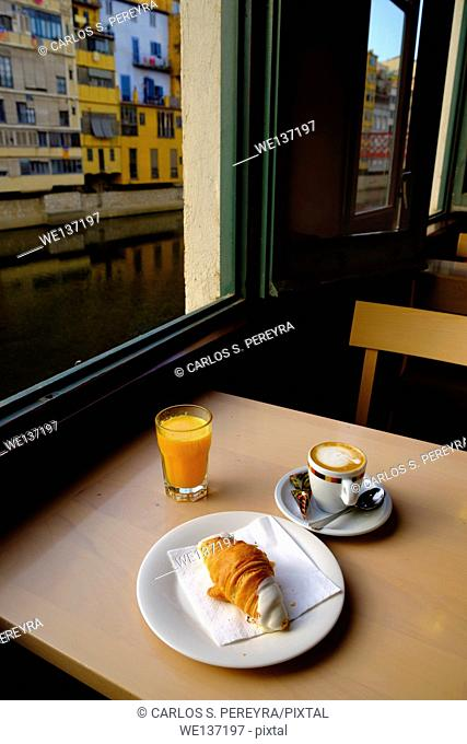 Breakfast and the Onyar river in Girona, Catalonia, Spain