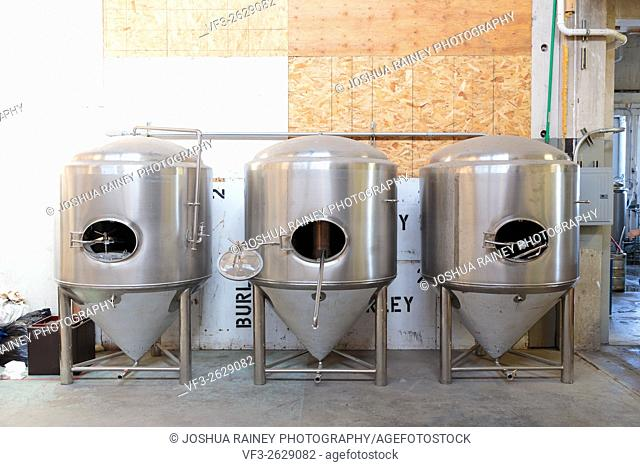 EUGENE, OR - NOVEMBER 4, 2015: Stainless steel commercial beer fermenter at the startup craft brewery Mancave Brewing