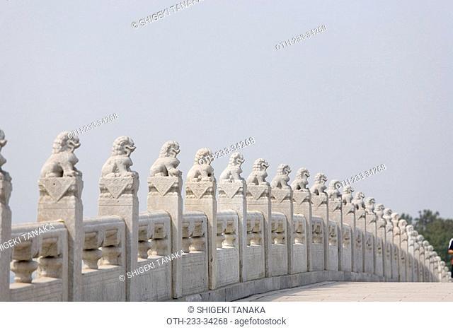Stone lions sculpture on the Seventeen-arch bridge, Summer Palace, Beijing, China