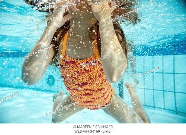 Girl under water in swimming pool